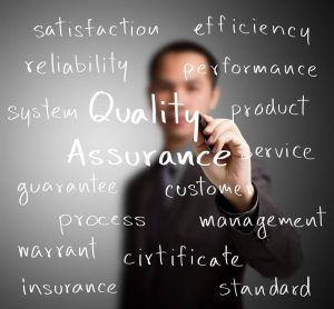 man-writing-quality-assurance-and-associated-words
